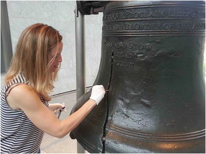 Darlene Cavalier, founder of SciStarter, swabs the Liberty Bell for microbes in Philadelphia.