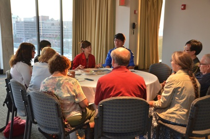 Rica, a Museum summer youth intern, facilitates a discussion about urban air quality issues. Photo by David Rabkin, Museum of Science.