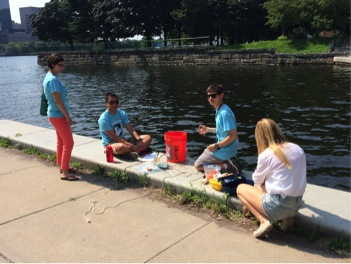 Summer Youth Interns collecting water quality samples on the Charles with two expert mentors from Northeastern University's Marine Science Center. Photo by David Sittenfeld, Museum of Science.