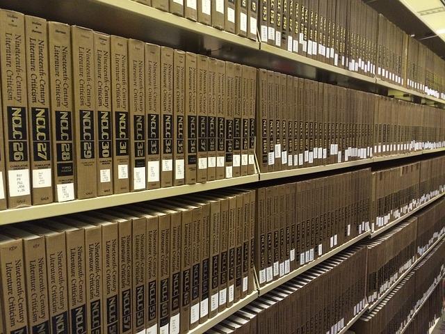 Books on a library shelf (CC0 Public Domain)