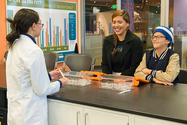 two museum visitors having genetics testing