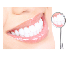 white teeth reflected in a mirror