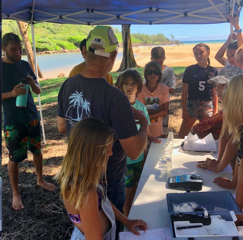 Dr. Carl Berg, Senior Scientist with Surfrider Kauai, introduces students to water quality science. Photo credit: Surfrieder Kauai.