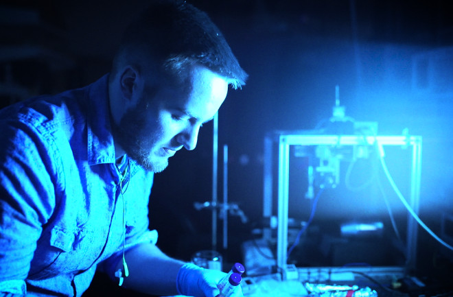 Researcher at work in lab that studies Alzheimer's disease.
